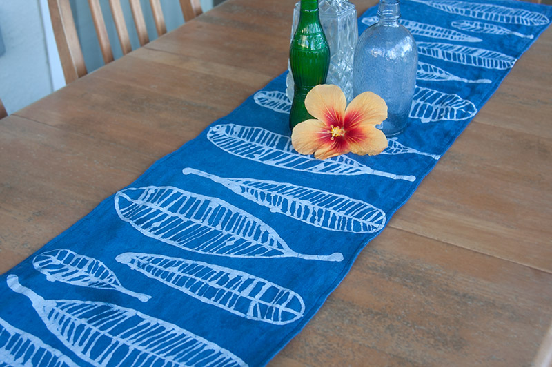 Blue table runner with contrasting motif.